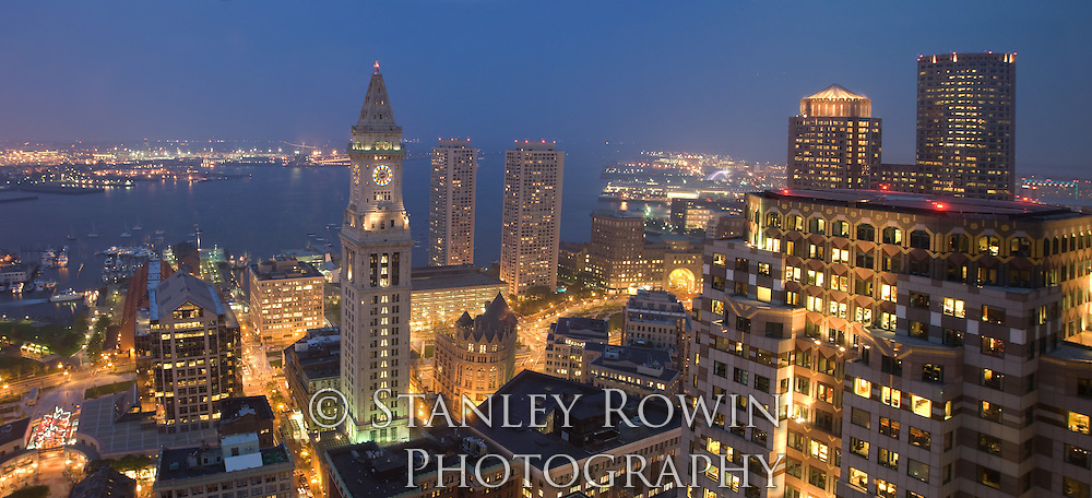 Aerial nighttime photo of downtown Boston and Customs House Tower