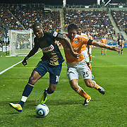 Union Attacker Danny Mwanga #10 try to keep possession of the ball while Dynamo Attacker Brian Ching #25 defends him from behind during Saturday MLS regular season match. The Dynamo and The Philadelphia Union played to a 1-1 tie. Saturday Aug. 6, 2011. at PPL Park in Chester PA...The News Journal/SAQUAN STIMPSON