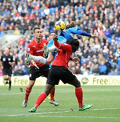 Hull City's Nikica Jelavic appears to foul Cardiff City's Kenwyne Jones in the area but Referee, Howard Webb doesn't award a penalty - Photo mandatory by-line: Joe Meredith/JMP - Tel: Mobile: 07966 386802 22/02/2014 - SPORT - FOOTBALL - Cardiff - Cardiff City Stadium - Cardiff City v Hull City - Barclays Premier League
