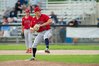 KELOWNA, BC - JULY 16:  Sam Wyatt #10 of the Wenatchee Applesox winds up for the pitch against the the Kelowna Falcons at Elks Stadium on July 16, 2019 in Kelowna, Canada. (Photo by Marissa Baecker/Shoot the Breeze)