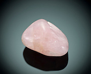 Cutout of a rose quartz gemstone on black background