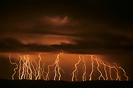 Time exposure of active lightning storm passing along the Sierra Nacimiento, New Mexico