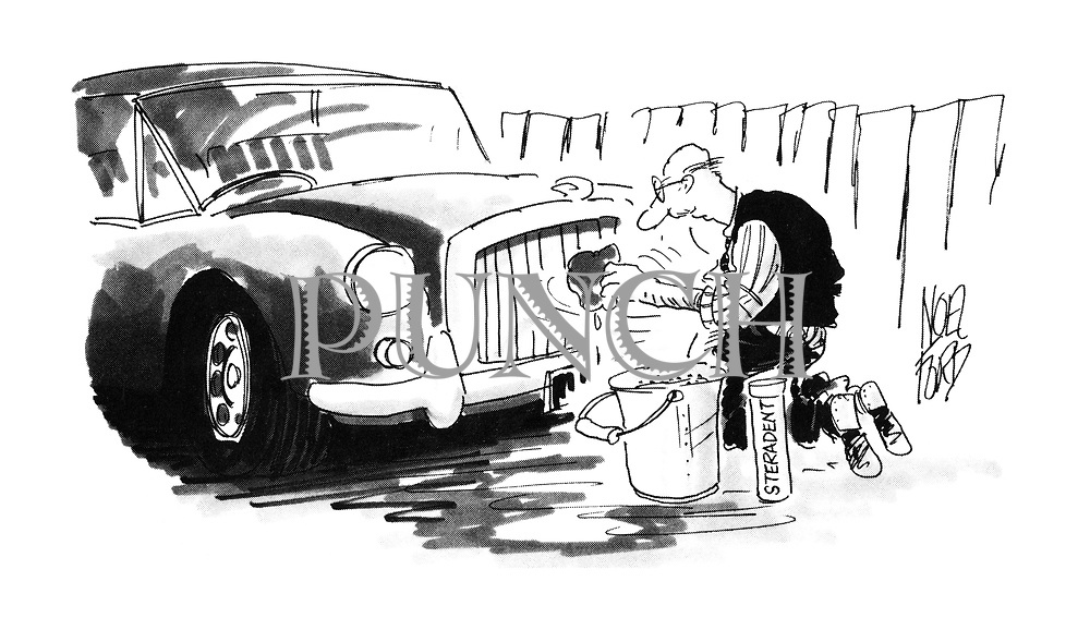 (Old man washing his radiator grill with Steradent)