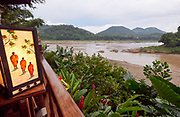 Laos. Luang Prabang. Confluence of Mekong (l.) and Nam Khan rivers. Lampshade with monks.