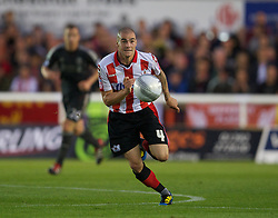 EXETER, ENGLAND - Wednesday, August 24, 2011: Exeter City's James Dunne in action against Liverpool during the Football League Cup 2nd Round match at St James Park. (Pic by David Rawcliffe/Propaganda)