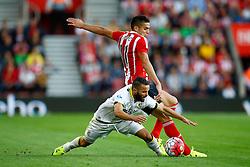 Lewis Baker of Vitesse Arnhem is tackled by Dusan Tadic of Southampton - Mandatory by-line: Jason Brown/JMP - Mobile 07966386802 - 31/07/2015 - SPORT - FOOTBALL - Southampton, St Mary's Stadium - Southampton v Vitesse Arnhem - Europa League