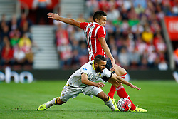 Lewis Baker of Vitesse Arnhem is tackled by Dusan Tadic of Southampton - Mandatory by-line: Jason Brown/JMP - Mobile 07966386802 - 31/07/2015 - SPORT - FOOTBALL - Southampton, St Mary's Stadium - Southampton v Vitesse Arnhem - Europa League