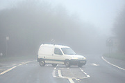 © Licensed to London News Pictures. 26/12/2013. Oxfordshire, UK A van crosses a junction in heavy fog. Foggy driving conditions on the M40 in Oxfordshire today. Photo credit : Stephen Simpson/LNP