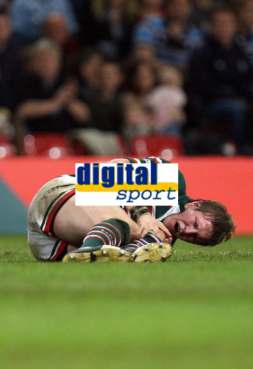 Photo: Rich Eaton.<br /> <br /> Cardiff Blues v Leicester Tigers. Heineken Cup. 29/10/2006. Ollie Smith of Leicester Tigers clutches his left knee in pain after a tackle by Tom Shanklin of Blues