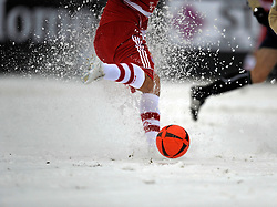 Players battle in the snow during the game between FC Eintracht Bamberg v FC Bayern München in Weismain, Germany, Bundelsiga, 17th Jan 09.