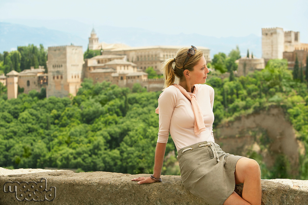 Tourist Relaxing on City Wall Granada Spain