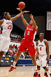 March 19, 2011; Stanford, CA, USA; St. John's Red Storm forward Da'Shena Stevens (3) shoots over Texas Tech Lady Raiders forward/center Kierra Mallard (20) during the first half of the first round of the 2011 NCAA women's basketball tournament at Maples Pavilion. St. John's defeated Texas Tech 55-50.