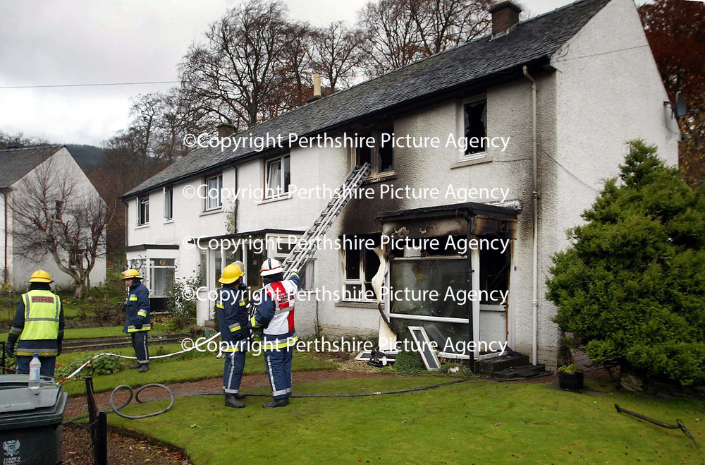 Firefighters at the scene of the fatal house fire in Aberfeldy Road, Kenmore, Perthshire where a man died.<br />see story by Gordon Currie.  Tel 01738 446766<br /><br />Picture by Graeme Hart.<br />Copyright Perthshire Picture Agency<br />Tel: 01738 623350  Mobile: 07990 594431