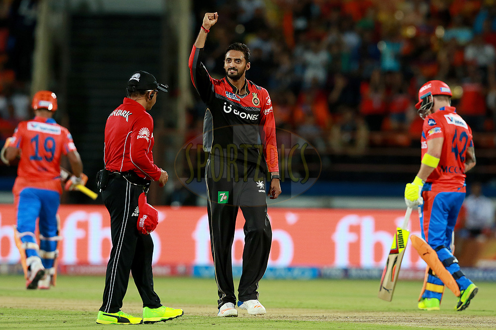 Sreenath Aravind of RCB celebrates the wicket of Dinesh Karthik of GL during match 20 of the Vivo 2017 Indian Premier League between the Gujarat Lions and the Royal Challengers Bangalore  held at the Saurashtra Cricket Association Stadium in Rajkot, India on the 18th April 2017<br /> <br /> Photo by Rahul Gulati - Sportzpics - IPL
