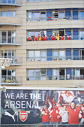LONDON, ENGLAND - Sunday, August 14, 2016: Supporters living near the stadium hanging Arsenal shirts from their balcony before the FA Premier League match between Arsenal and Liverpool at the Emirates Stadium. (Pic by David Rawcliffe/Propaganda)