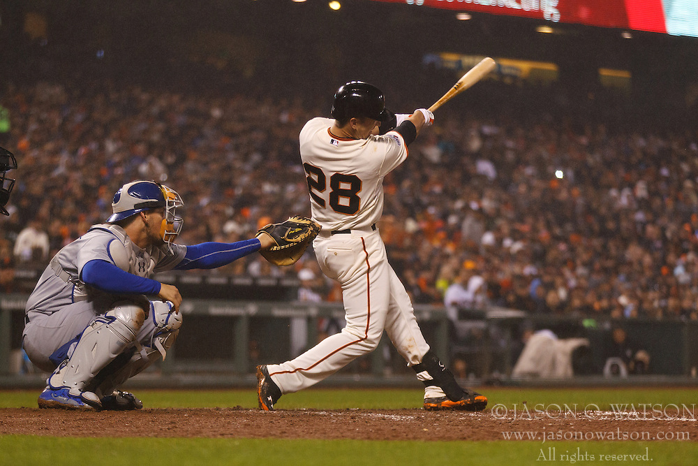 SAN FRANCISCO, CA - MAY 20:  Buster Posey #28 of the San Francisco Giants hits a home run against the Los Angeles Dodgers during the seventh inning at AT&T Park on May 20, 2015 in San Francisco, California.  The San Francisco Giants defeated the Los Angeles Dodgers 4-0. (Photo by Jason O. Watson/Getty Images) *** Local Caption *** Buster Posey