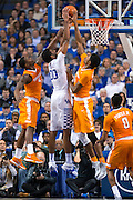 Kentucky forward Marcus Lee, center, has his shot contested by Tennessee forward Armani Moore, left, and forward Kyle Alexander.<br /> <br /> The University of Kentucky hosted the University of Tennessee, Thursday, Feb. 18, 2016 at Rupp Arena in Lexington.