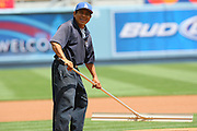 LOS ANGELES - MAY 03:  A groundskeeper smiles while working on the pitcher's mound at the Los Angeles Dodgers game against the San Diego Padres at Dodger Stadium on Sunday, May 3, 2009 in Los Angeles, California.  The Dodgers won their 10th straight home game while defeating the Padres 7-3.  (Photo by Paul Spinelli/MLB Photos)