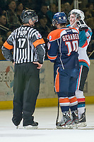 KELOWNA, CANADA, JANUARY 25: Colton Sissons #15 of the Kelowna Rockets and Chase Schaber #10 of the Kamloops Blazers listen to the call of referee Steve Papp as the Kamloops Blazers visit the Kelowna Rockets on January 25, 2012 at Prospera Place in Kelowna, British Columbia, Canada (Photo by Marissa Baecker/Getty Images) *** Local Caption ***
