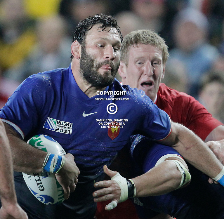 AUCKLAND, NEW ZEALAND - OCTOBER 15, Bradley Davies looks to takle Lionel Nallet during the 2011 IRB Rugby World Cup Semi Final match between Wales and France at Eden Park on October 15, 2011 in Auckland, New Zealand<br /> Photo by Steve Haag / Gallo Images