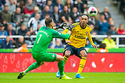 Martin Dubravka (#1) of Newcastle United FC makes a save from Pierre-Emerick Aubameyang (#14) of Arsenal FC during the Premier League match between Newcastle United and Arsenal at St. James's Park, Newcastle, England on 11 August 2019.