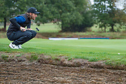 Tommy Fleetwood of England sizes up a putt during the British Masters 2018 at Walton Heath Golf Course, Walton On the Hill, Surrey on 14 October 2018. Picture by Martin Cole.
