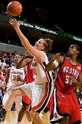 Virginia forward Kelly Hartig (42) reaches for a rebound against N.C. State guard Sharnise Beal (31).  The Virginia Cavaliers defeated the NC State Wolfpack women's basketball team 74-49 at the John Paul Jones Arena in Charlottesville, VA on February 1, 2008.