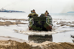 U.S. Marines with Assault Amphibious Vehicle Platoon, Echo Company, Battalion Landing Team 2nd Battalion, 5th Marines, 31st Marine Expeditionary Unit and the Philippine Marine Corps land on the beach in assault amphibious vehicles during KAMANDAG 2 in Subic Bay, Philippines, Oct. 3, 2018. KAMANDAG helps maintain a high level of readiness and enhances bilateral military-to-military relations and capabilities. (U.S. Marine corps photo by LCpl. Christine Phelps)