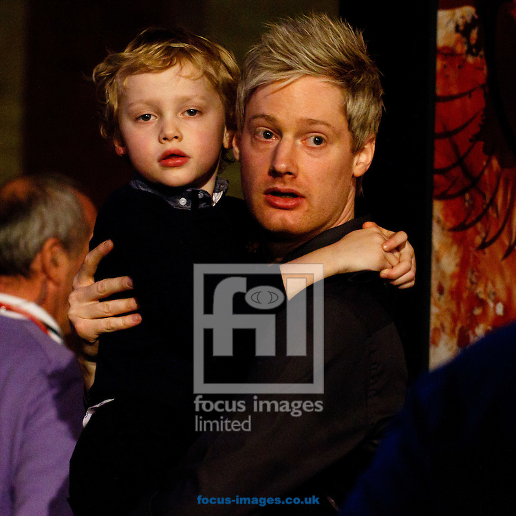 Neil Robertson hugs his son Alexander after winning the first semi final of The Dafabet World Snooker Masters at Alexandra Palace, London<br /> Picture by Mark Chappell/Focus Images Ltd +44 77927 63340<br /> 17/01/2015
