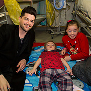 NO REPRO FEE<br /> 25/12/2014<br /> Special visitors on Christmas Day in Temple Street Children&rsquo;s Hospital<br /> Danny from the Script makes little kid&rsquo;s Christmas with hospital visit.<br /> Pictured here are Danny with Billy Goulding from Tipperary and sister Rachel.<br /> Danny O&rsquo;Donoghue showed a heart of gold when he turned up at Temple Street&rsquo;s Children&rsquo;s Hospital on Christmas Day. The Script&rsquo;s frontman spent a number of hours on Christmas morning visiting children at their bedside along with Santa, the Lord Mayo.&nbsp;Last year, almost 400 children were cared for in Temple Street on Christmas Eve and Christmas Day &amp; a visit from Danny helped bring the magic of Christmas to Temple Street for the children and babies who are too ill or weak to make it home. Danny said of his work with Temple Street &ldquo;It&rsquo;s amazing to be involved with Temple Street, it&rsquo;s the greatest hospital on the planet. It&rsquo;s really humbling to see the children, families, doctors and nurses in Temple Street; they are all true superheroes.&quot;<br /> Pic: Alan Rowlette Photography<br /> -ENDS-