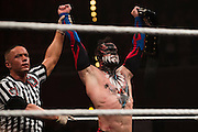 Finn Balor celebrates after defeating Samoa Joe to retain the NXT Championship during NXT Takeover: Dallas on April 1, 2016 in Dallas, Texas.