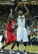 January 04 2010: Iowa Hawkeyes forward Melsahn Basabe (1) puts up a shot as Ohio State Buckeyes forward Dallas Lauderdale (52) defends during the first half of an NCAA college basketball game at Carver-Hawkeye Arena in Iowa City, Iowa on January 04, 2010. Ohio State defeated Iowa 73-68.
