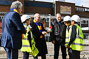 Council Leader Stephen Alambritis (far left) AFC Wimbledon legend Ian Cooke (centre left), AFC Wimbledon legend Dave Bassett (centre right) and children from both Smallwood Primary School and children from AFC Wimbledon player development programme during the AFC Wimbledon Demolition Event, marking the start of building works at the AFC Wimbledon Stadium Site, Plough Lane, United Kingdom on 16 March 2018. Picture by Stephen Wright.