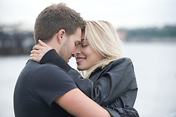Young couple romantically embracing face to face