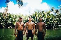 Three young Chamorro men near a cultural village in the interior of Guam.