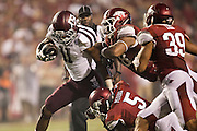 FAYETTEVILLE, AR - SEPTEMBER 28:  Derel Walker #11 of the Texas A&M Aggies is tackled by Otha Peters #5 of the Arkansas Razorbacks at Razorback Stadium on September 28, 2013 in Fayetteville, Arkansas.  The Aggies defeated the Razorbacks 45-33.  (Photo by Wesley Hitt/Getty Images) *** Local Caption *** Derel Walker; Otha Peters