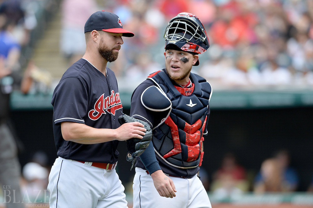 Jul 31, 2016; Cleveland, OH, USA; Cleveland Indians starting pitcher Corey Kluber (28) walks off the field with catcher Roberto Perez (55) during the fifth inning at Progressive Field. Mandatory Credit: Ken Blaze-USA TODAY Sports