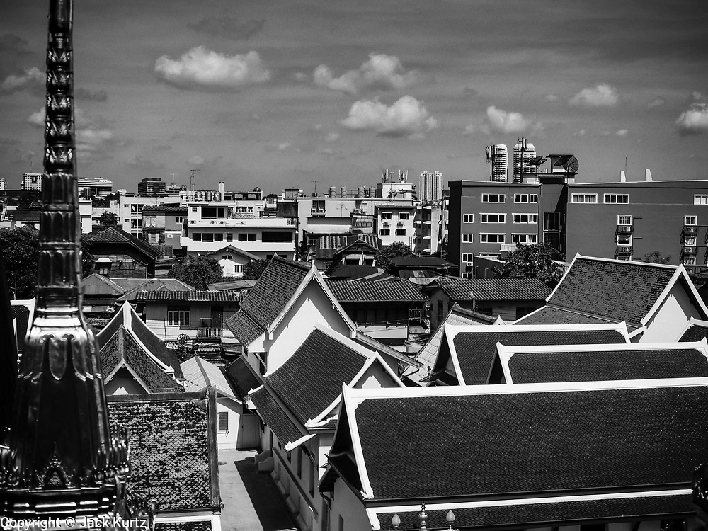 10 APRIL 2017 - BANGKOK, THAILAND:  The Bangkok skyline as seen from Wat Ratchanatdaram, a Buddhist temple in Phra Nakhon district, Bangkok. It means Temple of the Royal Niece, the temple was built on the orders of King Nangklao (Rama III) for the princess granddaughter, Somanass Waddhanawathy in 1846.      PHOTO BY JACK KURTZ