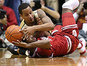 Purdue Boilermakers forward Vince Edwards tangles with Indiana Hoosiers guard Robert Johnson for a loose ball late in the second half. Purdue hosted Indiana at Mackey Arena Wednesday, January 28, 2015.