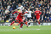 Cardiff City striker Kenwyne Jones using his strength during the Sky Bet Championship match between Derby County and Cardiff City at the iPro Stadium, Derby, England on 21 November 2015. Photo by Aaron Lupton.