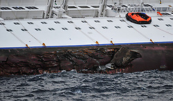 "The side off the Wrecked Cruise Ship ""Costa Concordia"" in Giglio, Italy, as the ship starts to move. Photo By Nick Cornish/ I-Images."