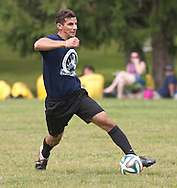 Goshen, New York -  A men's soccer player dribbles the ball in the Sweitzer Cup benefit tournament on Aug. 2, 2014.