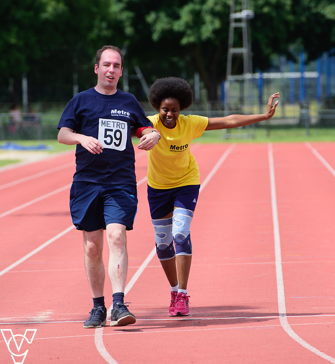 Metro Blind Sport's 2017 Athletics Open held at Mile End Stadium.  200m Senior Men - Final.  Vanja Sudar with guide runner, left, and Tim Morrice with guide runner<br /> <br /> Picture: Chris Vaughan Photography for Metro Blind Sport<br /> Date: June 17, 2017