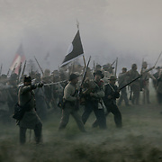 A Confederate unit charged forward on the battlefield during the sunrise battle, a reenactment of the Battle of Pottsville, during the weekend celebration of the Battle of Perryville, which serves as the national Civil War reenactment for 2006, at the Perryville Battlefield in Perryville, Ky. on Oct. 7, 2006. David Stephenson/Staff