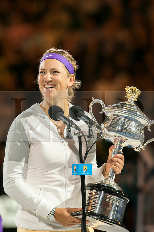 © Licensed to London News Pictures. 26/01/2013. Melbourne Park, Australia. Victoria Azarenka smiles while she holds up the winner trophy during the Womens Final between Victoria Azarenka and Li Na of the Australian Open. Photo credit : Asanka Brendon Ratnayake/LNP