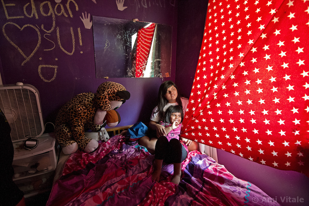 Zayda Hernandez, 14, and Ayasha, 4 play on the Moapa reservation in Nevada. All of their family suffers from Asthma and though they can't prove it, believe its because of the coal plant next door. Her grandfather died in march because of cancer. The Sierra Club is working with the Moapa Band of Paiutes to transition NV Energy away from the Reid Gardner coal-fired power plant -- which sits only 45 miles from Las Vegas and a short walk from community housing at the Moapa River Indian Reservation. The Reid Gardner coal plant is literally spewing out tons of airborne pollutants such as mercury, nitrous oxide, sulfur dioxide, and greenhouse gases. This has resulted in substantial health impacts on the Moapa community, with a majority of tribal members reporting a sinus or respiratory ailment.