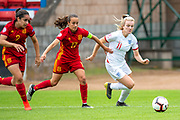 Lauren Hemp (#11) of England takes on Oihane Hernandez (#2) and Rosa Marquez (#17) of Spain during the UEFA Women's U19 European Championship match between England Women and Spain at Forthbank Stadium, Stirling, Scotland on 19 July 2019.