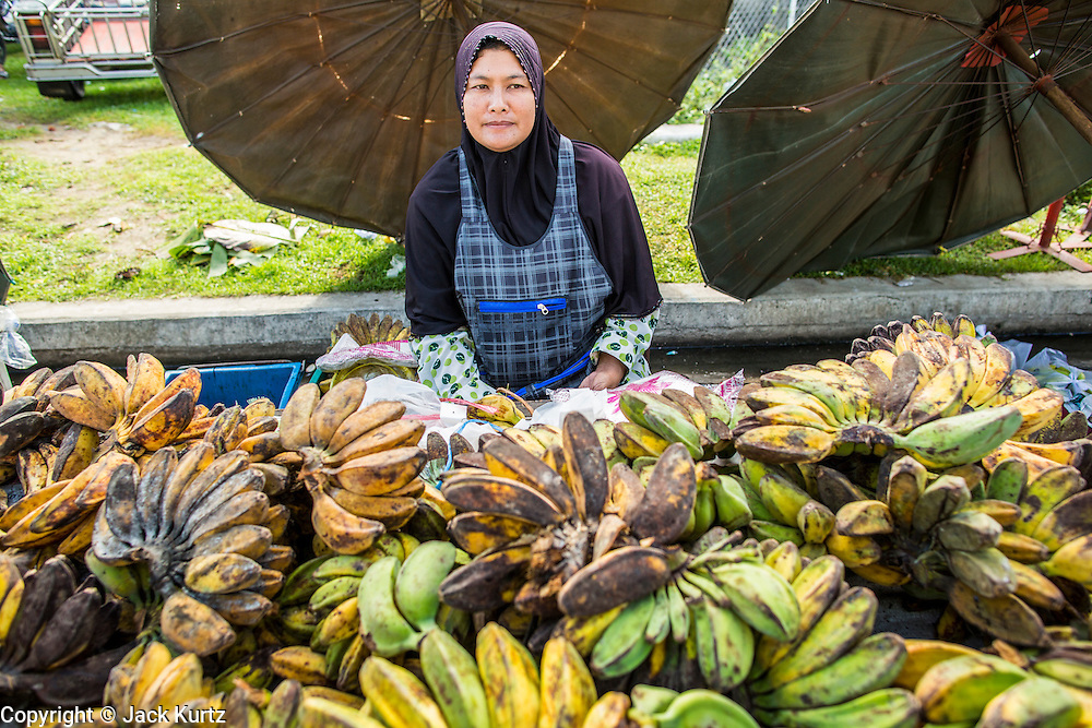 25 OCTOBER 2012 - PATTANI, PATTANI, THAILAND: A woman sells bananas in the market in Pattani, Thailand.      PHOTO BY JACK KURTZ