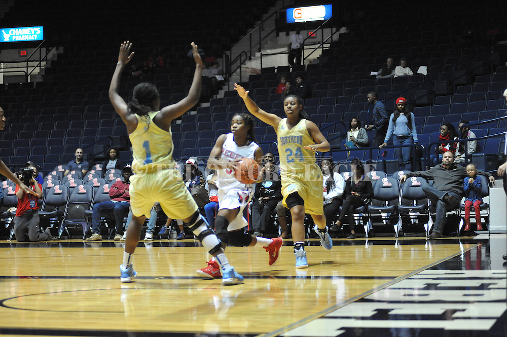 """Ole Miss guard Erika Sisk (5) vs. Southern University Jaguars guard Micah Garvin (24) at the C.M. """"Tad"""" Smith Coliseum in Oxford, Miss. on Thursday, November 20, 2014. (AP Photo/Oxford Eagle, Bruce Newman)"""
