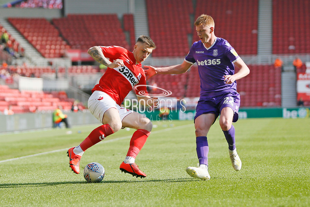 Middlesbrough forward Jordan Hugill (11)  and Stoke City midfielder Sam Lucas (22) during the EFL Sky Bet Championship match between Middlesbrough and Stoke City at the Riverside Stadium, Middlesbrough, England on 19 April 2019.